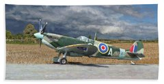 Spitfire Under Storm Clouds Beach Towel