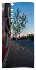 Beach Towel featuring the photograph St. Anne Street At Dusk by Darcy Michaelchuk