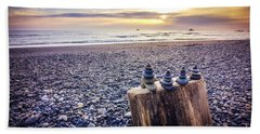 Stacked Rocks At Sunset Beach Towel