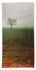 Standing Alone, A Lone Tree In The Fog. Beach Towel