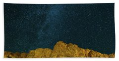 Starry Night Sky Over Rocky Landscape Beach Towel