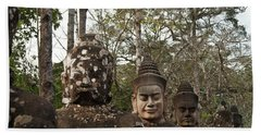 Statue Heads Ankor Thom Beach Towel
