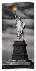 Statue Of Liberty At Dusk Beach Towel