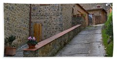 Steep Street In Montalcino Italy Beach Towel