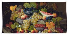 Still Life Of Melon Plums Grapes Cherries Strawberries On Stone Ledge Beach Towel by Severin Roesen