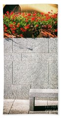 Beach Towel featuring the photograph Stone Bench With Flowers by Silvia Ganora