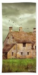 Stone Cottage And Stormy Sky Beach Towel by Jill Battaglia