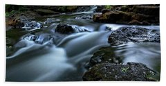 Stream Over Rocks Beach Towel by Charline Xia