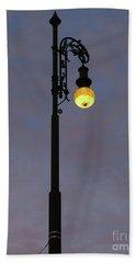 Beach Sheet featuring the photograph Street Lamp Shining At Dusk by Michal Boubin