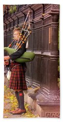 Street Performer Playing The Bagpipes Beach Towel