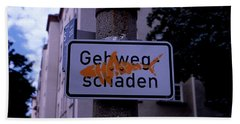 Street Sign With Graffiti Beach Towel