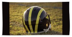 Striped Wolverine Helmet On The Field At Dawn Beach Towel