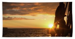 Sun On The Horizon Beach Towel