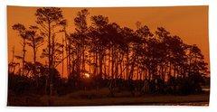Sunrise Along A Tree Line Beach Towel