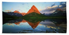 Sunrise At Many Glaciers Beach Towel