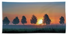 Beach Towel featuring the photograph Sunrise Behind The Cedars by Lori Coleman