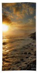 Sunrise By The Rocks Beach Towel