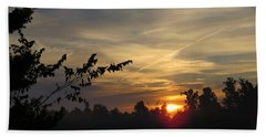 Sunrise Over The Trees Beach Towel