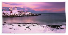 Sunset At Nubble Lighthouse In Maine In Winter Snow Beach Towel