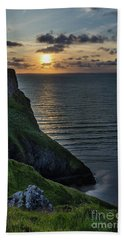 Sunset At Rhossili Bay Beach Towel
