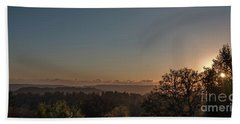 Sunset Behind Tree With Forest And Mountains In The Background Beach Towel