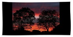 Sunset Behind Two Trees Beach Towel