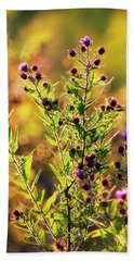 Beach Towel featuring the photograph Sunset Flowers by Christina Rollo