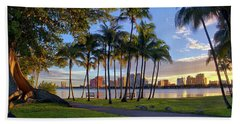 Sunset Over Downtown West Palm Beach From Palm Beach Island Beach Towel by Justin Kelefas