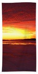 Sunset Over Frozen Lake Macatawa Beach Towel