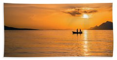 Sunset Over The Sea With Fishing Boat Beach Towel by Lana Enderle