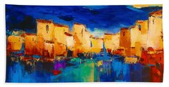 Sunset Over The Village Beach Towel