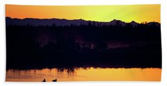 Beach Towel featuring the photograph Sunset Swim by Sue Collura