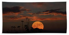 Super Moon And Silhouettes Beach Sheet by John Haldane