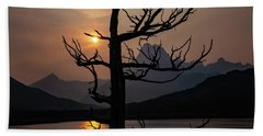 Beach Towel featuring the photograph Swiftcurrent Sunset by Lon Dittrick