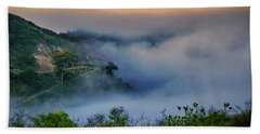 Beach Towel featuring the photograph Switchbacks In The Clouds by Joseph Hollingsworth
