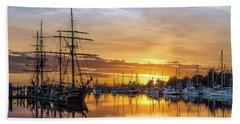 Tall Ships Sunset 1 Beach Towel by Greg Nyquist