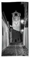Beach Towel featuring the photograph Tavira Church Bell Tower At Night - Portugal by Barry O Carroll