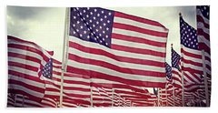 Beach Towel featuring the photograph The American Flag Proudly Stands by Luther Fine Art
