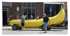 The Big Banana Car Stops By Beach Towel by Kent Lorentzen