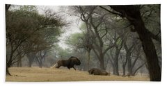 The Black Wildebeest Beach Towel by Ernie Echols