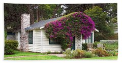 Beach Towel featuring the photograph The Honeymoon Cottage At Mission Ranch by Glenn McCarthy