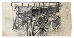 The First Fire Wagon Beach Towel