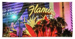 Beach Towel featuring the photograph The Flamingo Neon Sign And Palm Trees Wide by Aloha Art