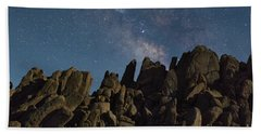 The Milky Way Over The Rocks Beach Towel