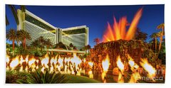 The Mirage Casino And Volcano Eruption At Dusk Beach Towel by Aloha Art