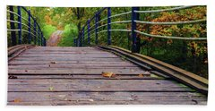 the old bridge over the river invites for a leisurely stroll in the autumn Park Beach Sheet