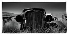 The Old Buick Beach Towel by Marius Sipa