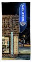 Beach Towel featuring the photograph The Old Packard Dealership by Susan Rissi Tregoning