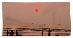 The Orange Moon Beach Towel