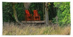 Beach Towel featuring the photograph The Red Chairs by Deborah Benoit